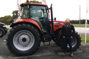 Jordan Andrews in front of tractor
