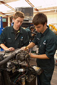 Automotive Engineering Students work on Engine